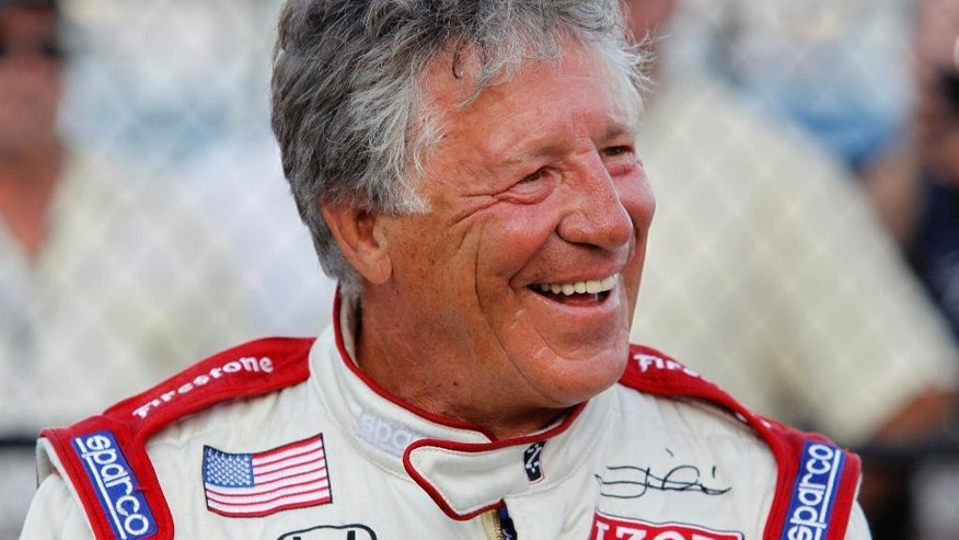 FILE - In this June 11, 2011, file photo, Mario Andretti smiles at Texas Motor Speedway in Fort Worth, Texas. IndyCar is returning to Road America for the first time since 2007 this Sunday, June 26, 2016. Tony Kanaan and Andretti, who won at the road course three times in the 1980s, are among the drivers eager for the return of the open wheel series to the sprawling, 4-mile track on a woody campus that resembles a campground.  (AP Photo/Sharon Ellman, File)