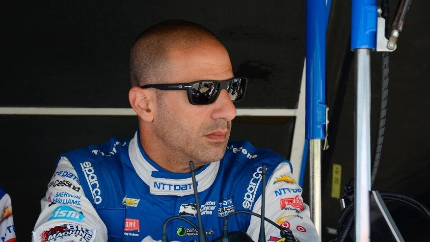 FILE - In this June 10, 2016 file photo, Tony Kanaan of Brazil sits by his pit as his team makes adjustments to his car during an Indycar auto racing practice at Texas Motor Speedway  in Fort Worth, Texas.   IndyCar is returning to Road America for the first time since 2007 on Sunday, June 26, 2016.  Kanaan and the retired Mario Andretti, who won at the road course three times in the 1980s, are among the drivers eager for the return of the open wheel series to the sprawling, 4-mile track on a woody campus that resembles a campground.(AP Photo/Larry Papke, file)