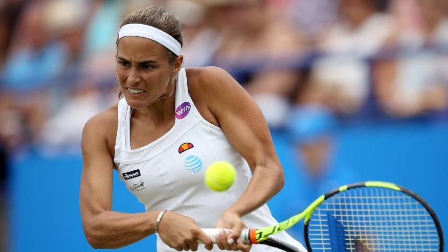 Puerto Rico's Monica Puig returns a shot against France's Kristina Mladenovic during day four of the 2016 Eastbourne International tennis tournament at at Devonshire Park, Eastbourne, England, Thursday, June 23, 2016. (Steve Paston/PA via AP)      UNITED KINGDOM OUT        -     NO SALES       -       NO ARCHIVES