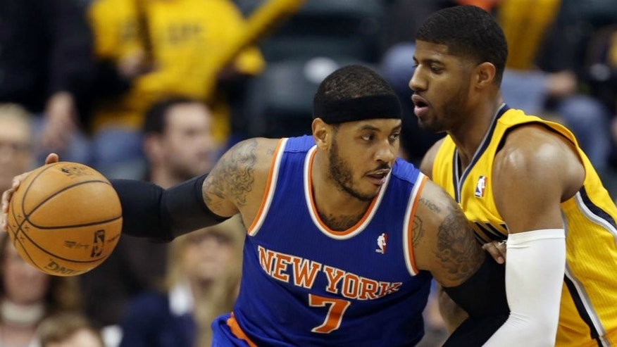<p>Jan 16, 2014; Indianapolis, IN, USA; New York Knicks forward Carmelo Anthony (7) is guarded by Indiana Pacers forward Paul George (24) at Bankers Life Fieldhouse. Indiana defeats New York 117- 89. Mandatory Credit: Brian Spurlock-USA TODAY Sports</p>