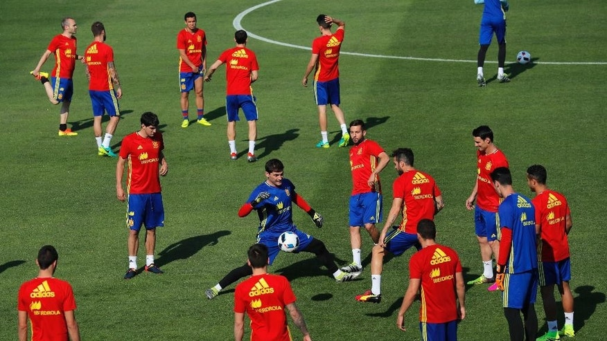 Spain's goalkeeper Iker Casillas, center, controls the ball surrounded by teammates during a training session at the Sports Complex Marcel Gaillard in Saint Martin de Re in France, Thursday, June 23, 2016. Spain will face Italy in a Euro 2016 round of 16 soccer match in Paris on Monday, June 27, 2016. (AP Photo/Manu Fernandez)