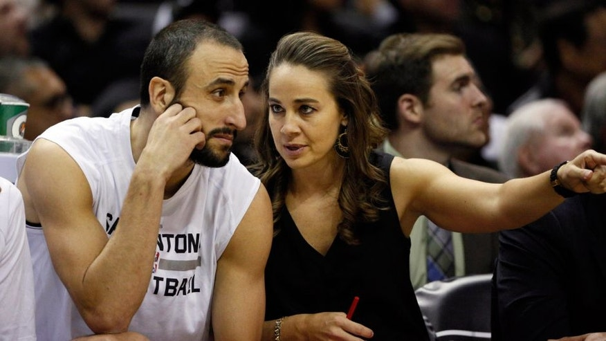 Nov 26, 2014; San Antonio, TX, USA; San Antonio Spurs assistant coach Becky Hammon (R) talks to shooting guard Manu Ginobili (20) during the first half against the Indiana Pacers at AT&T Center. Mandatory Credit: Soobum Im-USA TODAY Sports
