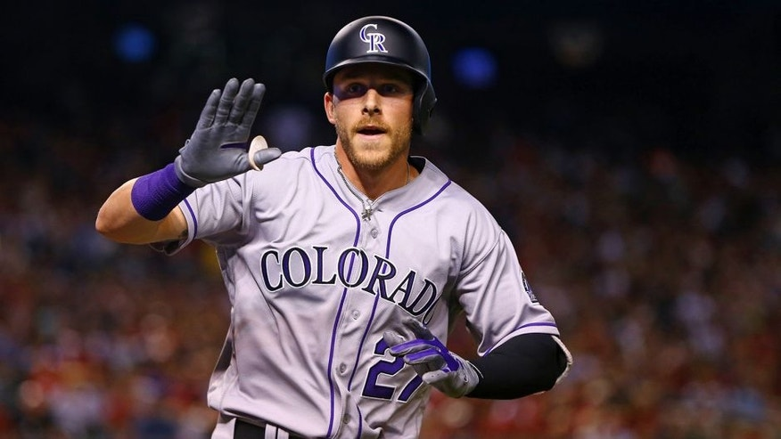 Apr 4, 2016; Phoenix, AZ, USA; Colorado Rockies shortstop Trevor Story celebrates after hitting a home run against the Arizona Diamondbacks during Opening Day at Chase Field. Mandatory Credit: Mark J. Rebilas-USA TODAY Sports