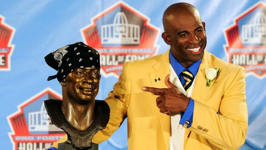 <p>Canto, OH - AUGUST 6: Former Atlanta Falcons cornerback Deion Sanders poses with his bust at the Enshrinement Ceremony for the Pro Football Hall of Fame in Canton, Ohio, Saturday, August 6, 2011. (Photo by Jason Miller/Getty Images) *** Local Caption *** Deion Sanders,CANTON, OH - AUGUST 6: Former Atlanta Falcons cornerback Deion Sanders poses with his bust at the Enshrinement Ceremony for the Pro Football Hall of Fame on August 6, 2011 in Canton, Ohio. (Photo by Jason Miller/Getty Images)</p>