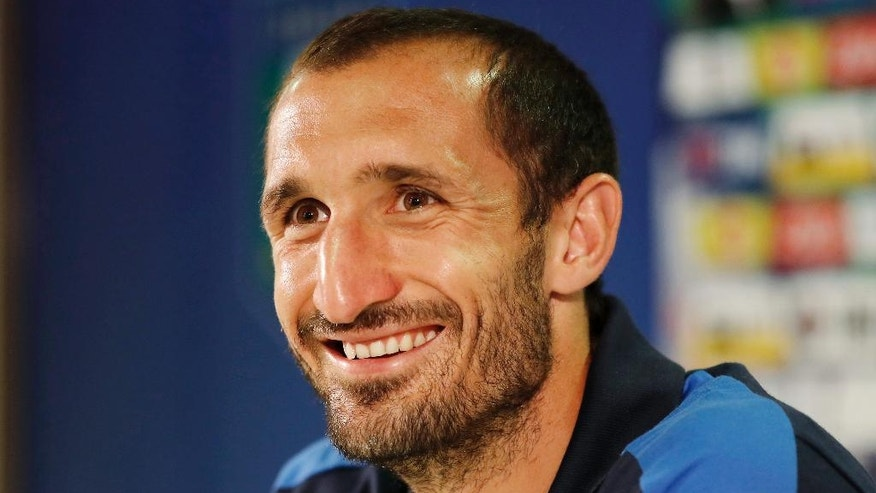 "Italy's Giorgio Chiellini smiles prior to the start of a press conference at the ""Casa Azzurri"" in Montpellier, France, Friday, June 24, 2016. Italy will face Spain in a Euro 2016 round of 16 soccer match in Paris on Monday, June 27, 2016. (AP Photo/Antonio Calanni)"
