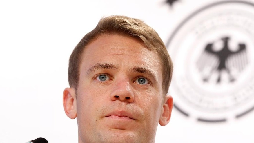 Manuel Neuer smiles during a press conference after a training session of the German national soccer team in the Camille Fournier stadium at their base camp in Evian-Les-Bains, France, Friday, June 24, 2016. Germany will face Slovakia in a Euro 2016 round of 16 match in Lille on Sunday, June, 26, 2016. (AP Photo/Michael Probst)