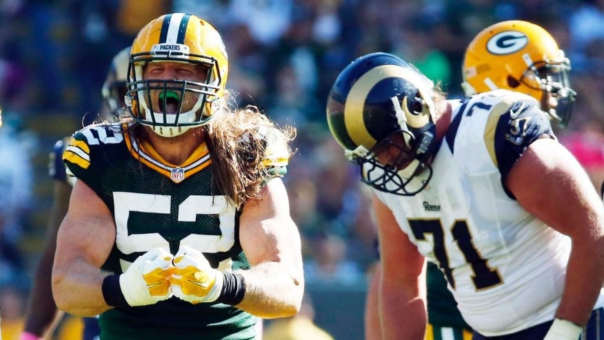 The Green Bay Packers' Clay Matthews celebrates after sacking St. Louis Rams quarterback Nick Foles during the second half on Sunday, Oct. 11, 2015, in Green Bay, Wis.