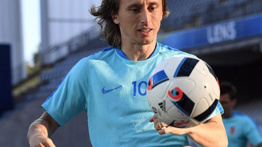 Croatia's Luka Modric attends a training session at the Bollaert-Delelis stadium in Lens, France, Friday, June 24, 2016. Croatia faces Portugal in a round of 16 match on Saturday, June 25,2016. (AP Photo/Geert Vanden Wijngaert)