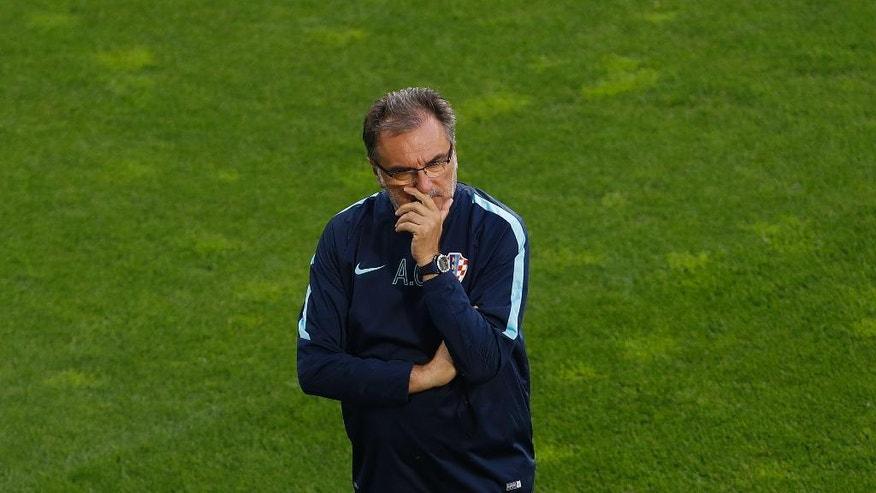 Croatia coach Ante Cacic attends a training session at the Bollaert-Delelis stadium in Lens, France, Friday, June 24, 2016. Croatia faces Portugal in a round of 16 match on Saturday, June 25,2016. (AP Photo/Darko Vojinovic)