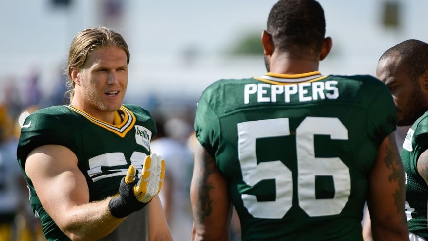 <p>Jul 30, 2014; Green Bay, WI, USA; Green Bay Packer linebacker Clay Matthews (left) talks to defensive end Julius Peppers during training camp at Ray Nitschke Field. Mandatory Credit: Benny Sieu-USA TODAY Sports</p>