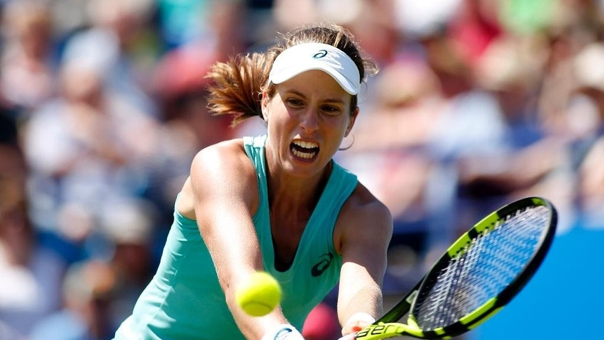 Britain's Johanna Konta  plays a return to Russia's Ekaterina Makarova, during their match in the Eastbourne International women's tennis tournament at Devonshire Park, Eastbourne England Friday June 24, 2016.(Steve Paston/PA via AP) UNITED KINGDOM OUT