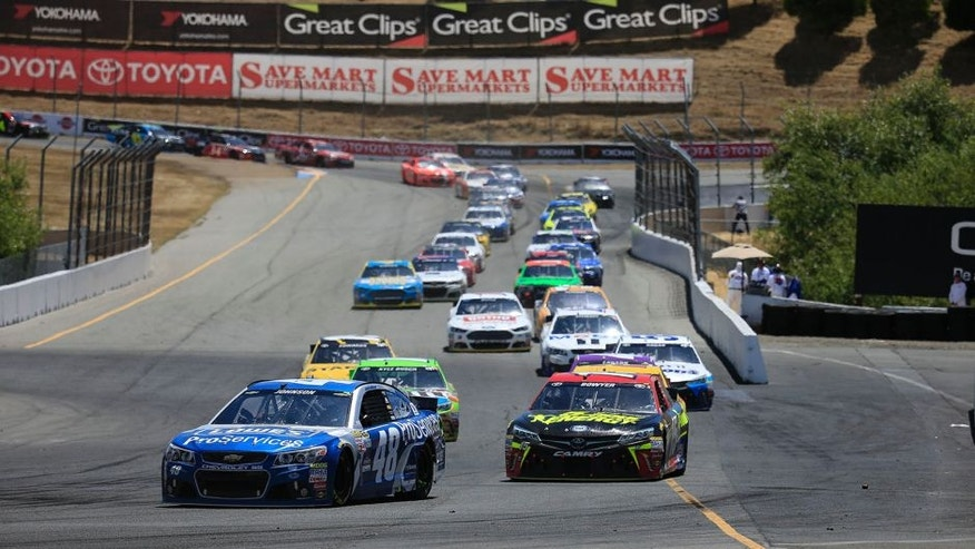 Jimmie Johnson, driver of the #48 Lowe's Pro Services Chevrolet, leads a pack of cars during the NASCAR Sprint Cup Series Toyota/Save Mart 350 at Sonoma Raceway on June 28, 2015 in Sonoma, California.