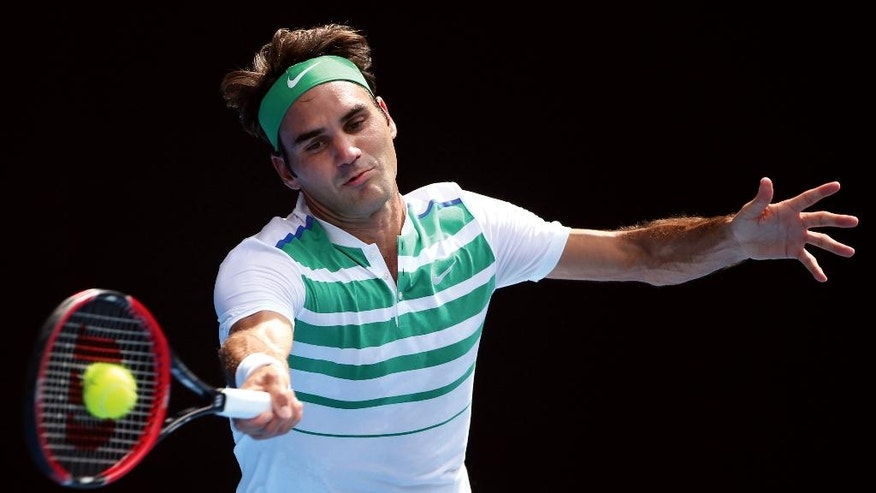 FILE - In this Jan. 26, 2016 file photo, Roger Federer of Switzerland plays a forehand return to Tomas Berdych of the Czech Republic during their quarterfinal match at the Australian Open tennis championships in Melbourne, Australia. (AP Photo/Rick Rycroft, File)