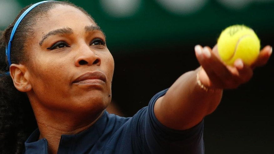 FILE - In this June 3, 2016 file photo, Serena Williams of the U.S. serves the ball in the semifinal match of the French Open tennis tournament against Netherlands' Kiki Bertens at the Roland Garros stadium in Paris, France.  (AP Photo/Alastair Grant, File)