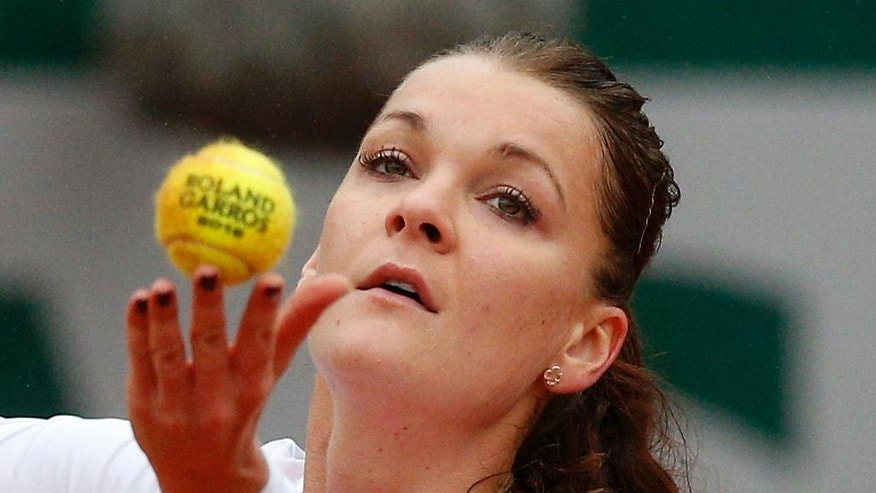 FILE - In this May 31, 2016 file photo, Poland's Agnieszka Radwanska serves the ball to Bulgaria's Tsvetana Pironkova during their fourth round match of the French Open tennis tournament at the Roland Garros stadium in Paris. (AP Photo/Christophe Ena, File)