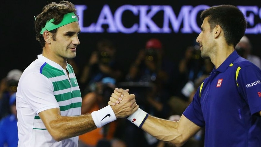 XXX of ZZZ plays a forehand in his/her semi final match against XXXX of ZZZZ during day 11 of the 2016 Australian Open at Melbourne Park on January 28, 2016 in Melbourne, Australia.,MELBOURNE, AUSTRALIA - JANUARY 28: Novak Djokovic of Serbia (R) shakes hands after winning in his semi final match against Roger Federer of Switzerland during day 11 of the 2016 Australian Open at Melbourne Park on January 28, 2016 in Melbourne, Australia. (Photo by Michael Dodge/Getty Images)