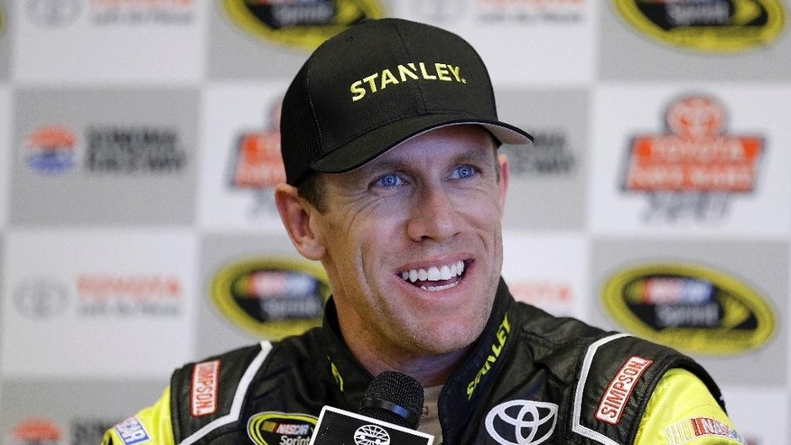Carl Edwards smiles during a media conference after qualifying for the pole position for Sunday's NASCAR Sprint Cup Series auto race Saturday, June 25, 2016, in Sonoma, Calif. (AP Photo/Ben Margot)