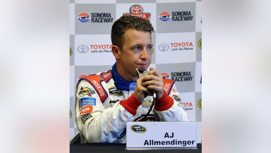 AJ Allmendinger answers questions from reporters during a media conference after qualifying for the NASCAR Sprint Cup Series auto race Saturday, June 25, 2016, in Sonoma, Calif. Allmendinger wll start in the second position beside pole winner Carl Edwards for the Toyota/Save Mart 3450 race on Sunday. (AP Photo/Ben Margot)