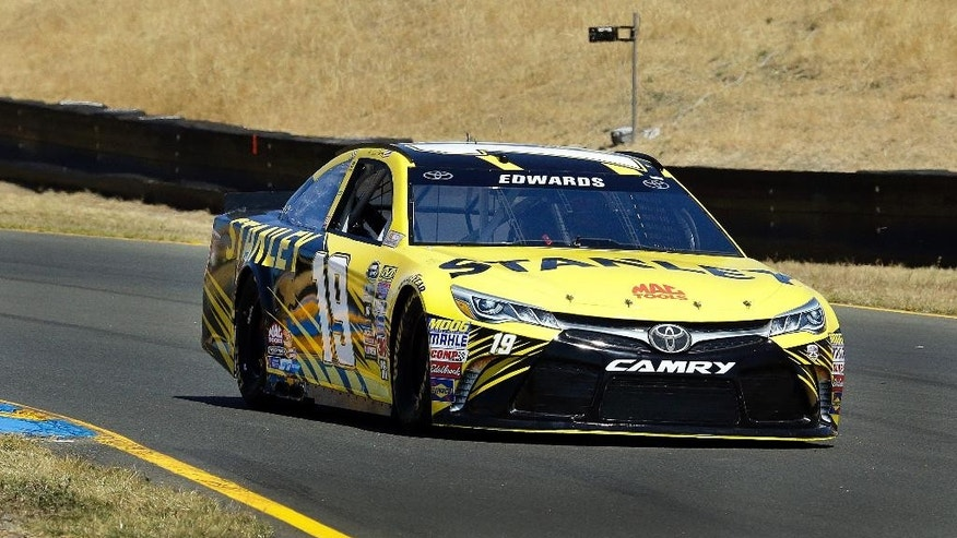 Carl Edwards drives during a qualifying lap for the NASCAR Sprint Cup Series auto race Saturday, June 25, 2016, in Sonoma, Calif. Carl Edwards won the pole position for Sunday's Toyota/Save Mart 350. (AP Photo/Ben Margot)