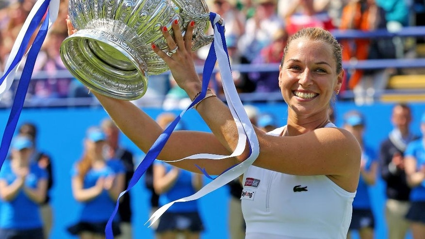 Slovakia's Dominika Cibulkova lifts the trophy after victory over Czech Republic's Karolina Pliskova during day six of the Eastbourne International women's tennis tournament at Devonshire Park, Eastbourne England, Saturday, June 25, 2016. (Gareth Fuller/PA via AP)      UNITED KINGDOM OUT       -      NO SALES       -      NO ARCHIVES