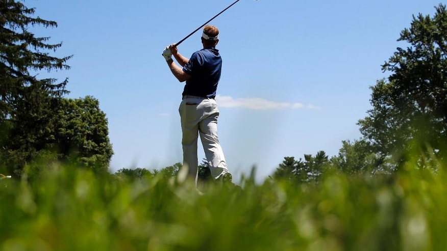 Billy Hurley III watches his shot from the third tee during the third round of the Quicken Loans National PGA golf tournament, Saturday, June 25, 2016, in Bethesda, Md. (AP Photo/Patrick Semansky)