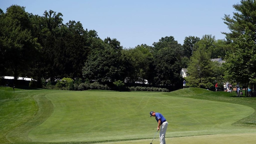 Ernie Els putts on the fifth green during the third round of the Quicken Loans National PGA golf tournament, Saturday, June 25, 2016, in Bethesda, Md. (AP Photo/Patrick Semansky)