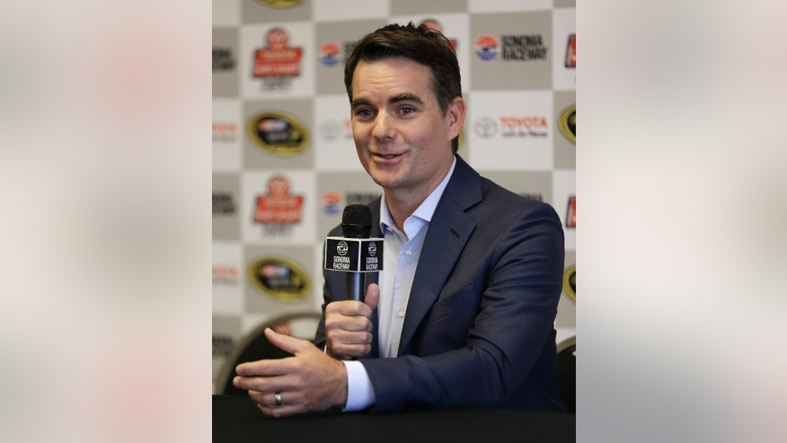 "Jeff Gordon gestures during a media conference prior to the qualifying session for the NASCAR Sprint Cup Series auto race on Saturday, June 25, 2016, in Sonoma, Calif. Gordon is open to succeeding Michael Strahan as Kelly Ripa's new ""Live"" co-host, so long as he could continue his new job as a NASCAR analyst. Gordon is calling his final race of the season Sunday for Fox Sports and then will head into the first significant downtime of his professional career. The four-time NASCAR champion is in his first year in the broadcast booth. He insisted Saturday he'll be back next year when Fox resumes coverage of the first half of the season. (AP Photo/Ben Margot)"