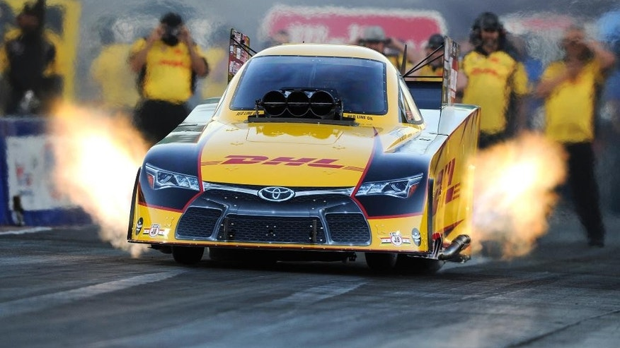 In this photo provided by NHRA, Del Worsham drives during Funny Car qualifying at the Summit Racing Equipment NHRA Nationals drag races, Friday, June 24, 2016, in Norwalk, Ohio. Worsham had a run of 3.875 seconds at 328.70 mph to take the provisional top spot. (Marc Gewertz/NHRA via AP)
