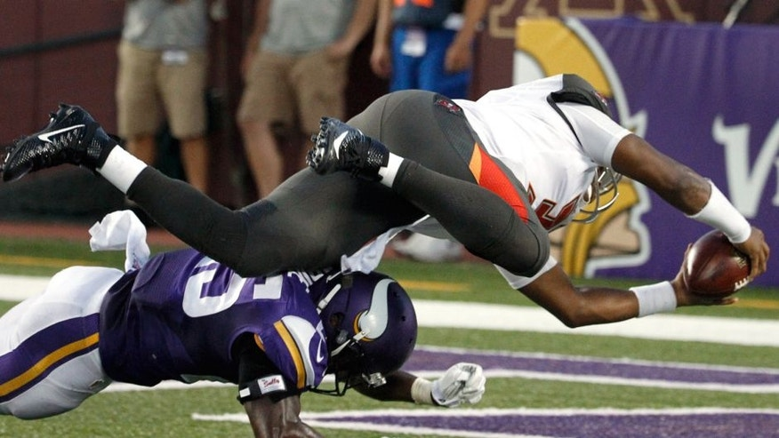 Tampa Bay Buccaneers quarterback Jameis Winston (3) dives over Minnesota Vikings cornerback Jabari Price (25) for an 8-yard touchdown during the first half of a preseason NFL football game Saturday, Aug. 15, 2015, in Minneapolis. (AP Photo/Ann Heisenfelt)