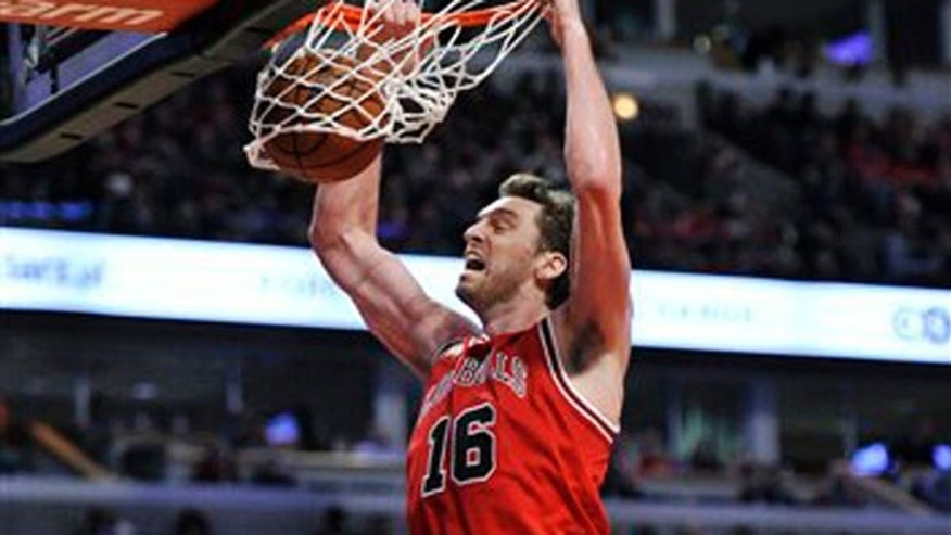 "FILE - This is a Saturday, March 5, 2016 file photo of Chicago Bulls' Pau Gasol (16), of Spain, as he dunks during the second half of an NBA basketball game against the Houston Rockets on in Chicago. Chicago won 108-100.  Pau Gasol says he is considering not playing at the Olympics because of the Zika virus. The Spanish basketball player says there is too much uncertainty about the situation in Brazil and anyone going to Rio de Janeiro for the games should ""think about"" whether it's worth the risk. (AP Photo/Paul Beaty, File)"