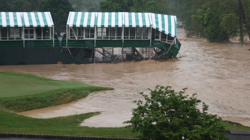 This Thursday June 23, 2016 image provided by the Greenbrier shows flooding on the 18th green of the Old White Course at the Greenbrier in White Sulphur Springs, W. Va. Severe flooding hit the area that is scheduled to host a PGA tour event in two weeks. (Cam Huffman/The Greenbrier via AP)