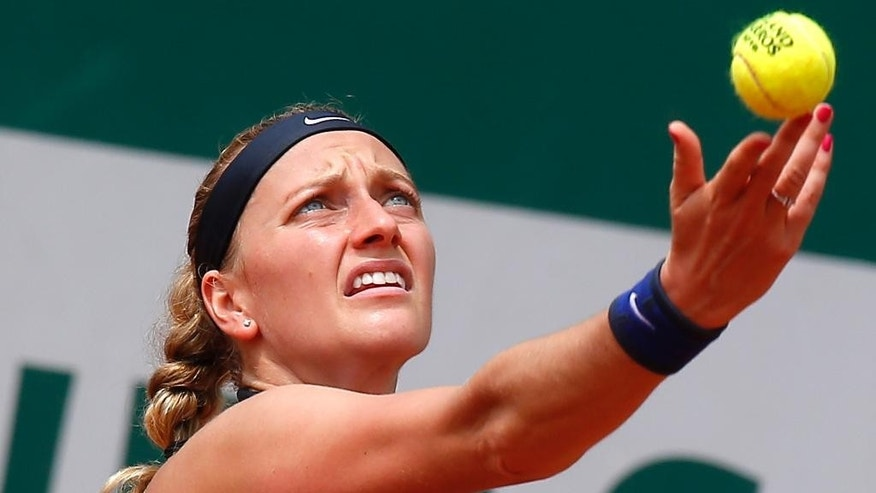 FILE - In this May 27, 2016 file photo, Petra Kvitova of the Czech Republic serves in her third round match of the French Open tennis tournament against Shelby Rogers of the U.S. at the Roland Garros stadium in Paris, France. (AP Photo/Michel Euler, File)