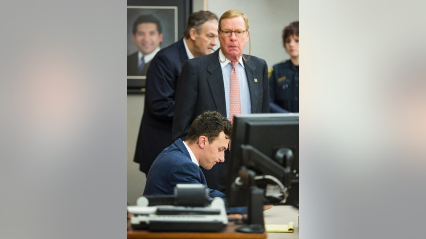 FILE - In this May 5, 2016 file photo, former Cleveland Browns quarterback Johnny Manziel sits at the defense table as his attorney Bob Hinton, center, looks on during a hearing, in Dallas. (Smiley N. Pool/The Dallas Morning News via AP, Pool)