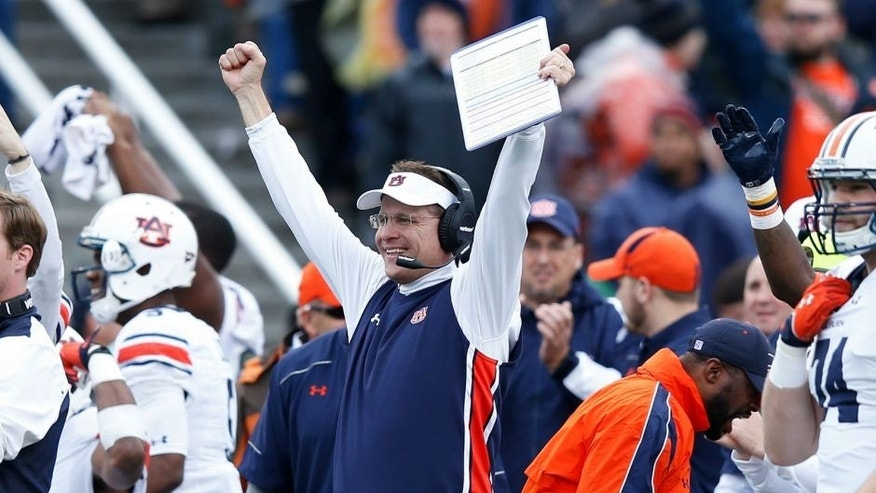 BIRMINGHAM, AL - DECEMBER 30: Head coach Gus Malzahn of the Auburn Tigers celebrates after a touchdown against the Memphis Tigers during the Birmingham Bowl at Legion Field on December 30, 2015 in Birmingham, Alabama. Auburn defeated Memphis 31-10. (Photo by Joe Robbins/Getty Images)