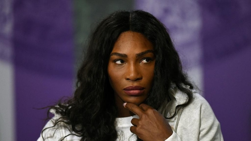 Serena Williams of the U.S gives her pre-Championships press conference at The All England Lawn Tennis Club, ahead of the Wimbledon Tennis Championships in London, Sunday, June 26, 2016. (Florian Eisele/Pool Photo via AP)
