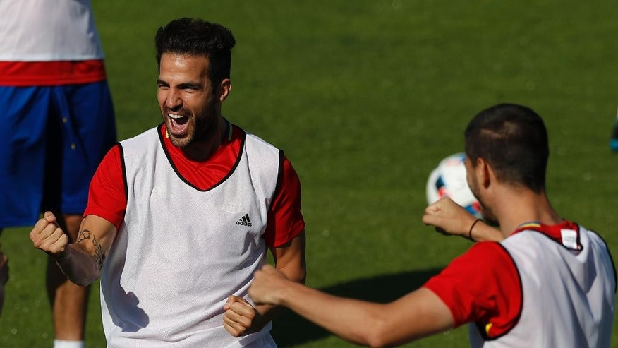 Spain's Cesc Fabregas, left, reacts during a training session at the Sports Complex Marcel Gaillard in Saint Martin de Re in France, Friday, June 24, 2016. Spain will face Italy in a Euro 2016 round of 16 soccer match in Paris on Monday, June 27, 2016. (AP Photo/Manu Fernandez)