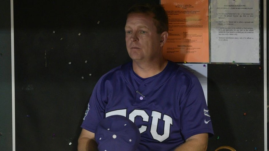 Jun 25, 2016; Omaha, NE, USA; TCU Horned Frogs head coach Jim Schlossnagle (22) looks out over the field after the loss against the Coastal Carolina Chanticleers in the 2016 College World Series at TD Ameritrade Park. Coastal Carolina defeated TCU 7-5. Mandatory Credit: Steven Branscombe-USA TODAY Sports
