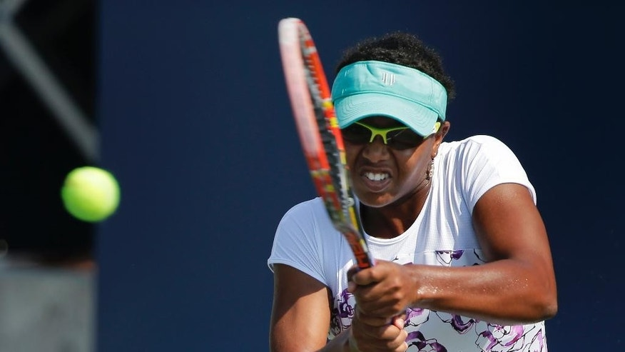 FILE - This is a Tuesday, Aug. 25, 2015  file photo of Vicky Duval, of the United States, returns a shot to Luksika Kumkhum, of Thailand, during the first set of a U.S. Open qualifying tennis match  in New York. Vicky Duval was back at Wimbledon on Monday,  June 27, 2016 competing in the grass-court Grand Slam tournament for the first time in two years after recovering from Hodgkin lymphoma.  (AP Photo/Julie Jacobson, File)