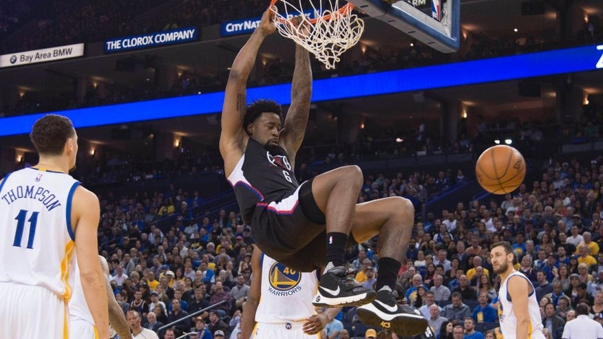 March 23, 2016; Oakland, CA, USA; Los Angeles Clippers center DeAndre Jordan (6) dunks the basketball against the Golden State Warriors during the second quarter at Oracle Arena. Mandatory Credit: Kyle Terada-USA TODAY Sports