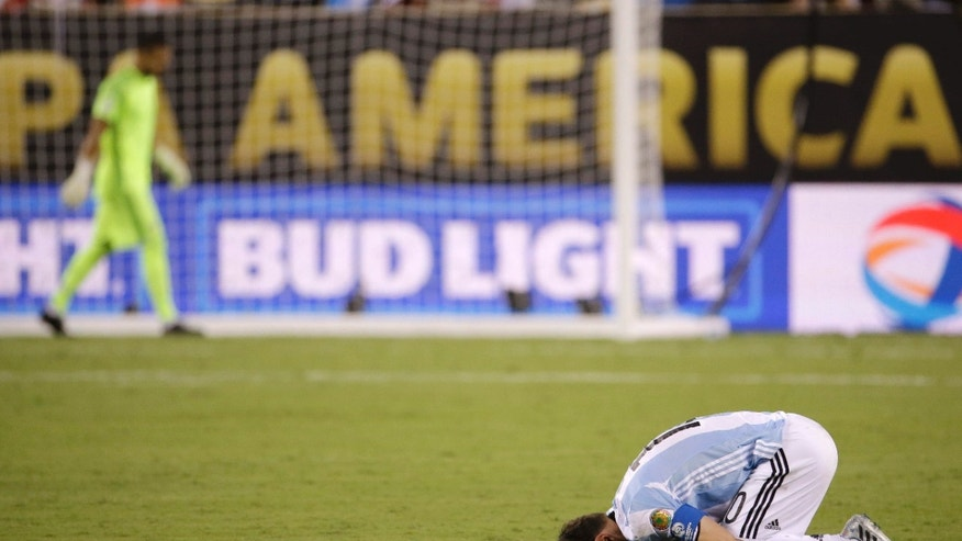 Argentina's Lionel Messi reacts after losing 4-2 to Chile in penalty kicks in the Copa America Centenario championship soccer match, Sunday, June 26, 2016, in East Rutherford, N.J.