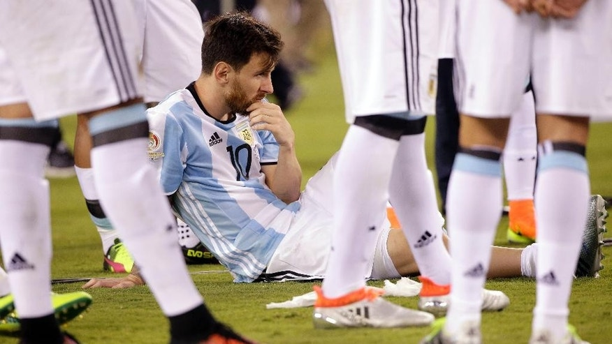 Argentina's Lionel Messi waits for trophy presentations after the Copa America Centenario championship soccer match, Sunday, June 26, 2016, in East Rutherford, N.J. Chile defeated Argentina 4-2 in penalty kicks to win the championship. (AP Photo/Julie Jacobson)