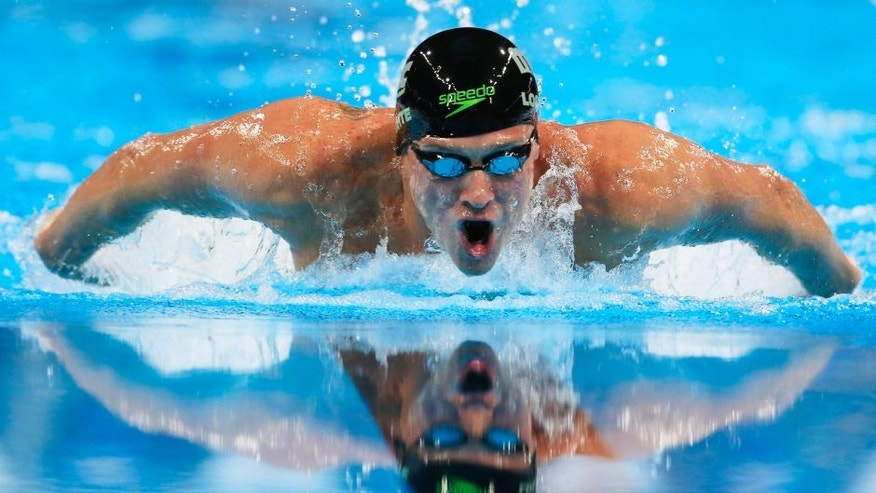 Ryan Lochte swims during the men's 400-meter Individual medley at the U.S. Olympic swimming trials in Omaha, Neb., Sunday, June 26, 2016. (AP Photo/Orlin Wagner)