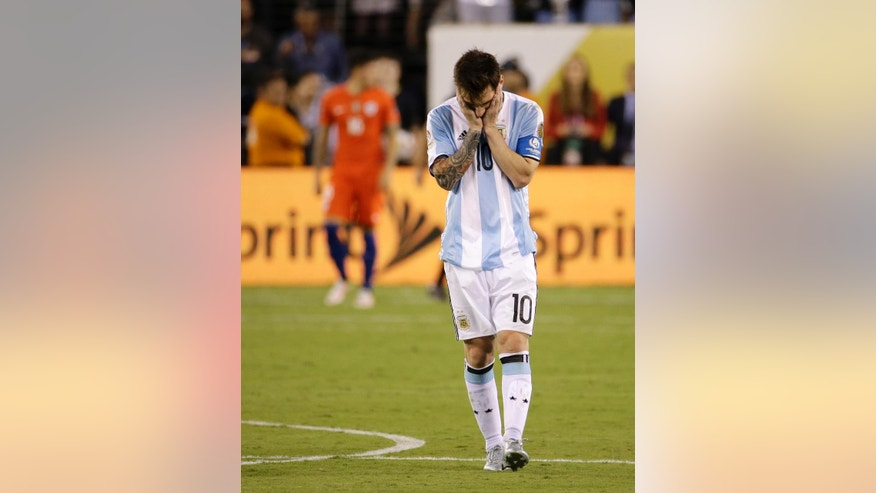 Argentina's Lionel Messi reacts after missing his shot during penalty kicks in the Copa America Centenario championship soccer match, Sunday, June 26, 2016, in East Rutherford, N.J. Chile defeated Argentina 4-2- in penalty kicks. (AP Photo/Julio Cortez)