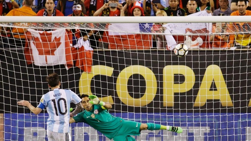 Argentina's Lionel Messi misses his shot during penalty kicks in the Copa America Centenario championship soccer match, Sunday, June 26, 2016, in East Rutherford, N.J. Chile defeated Argentina 4-2- in penalty kicks. (AP Photo/Julio Cortez)
