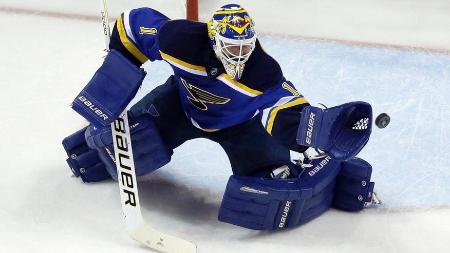 FILE - In this May 17, 2016, file photo, St. Louis Blues goalie Brian Elliott (1) makes a save during the second period in Game 2 of the NHL hockey Stanley Cup Western Conference finals against the San Jose Sharks, in St. Louis. A full year before the Las Vegas expansion draft, GMs must plan for the inevitability of losing a player to a team that the league wants to be good out of the gate. Already the impact of the impending expansion draft has been felt with the Calgary Flames acquiring Elliott and the Toronto Maple Leafs getting goalie Frederik Andersen from the Anaheim Ducks.  (AP Photo/Jeff Roberson, File)