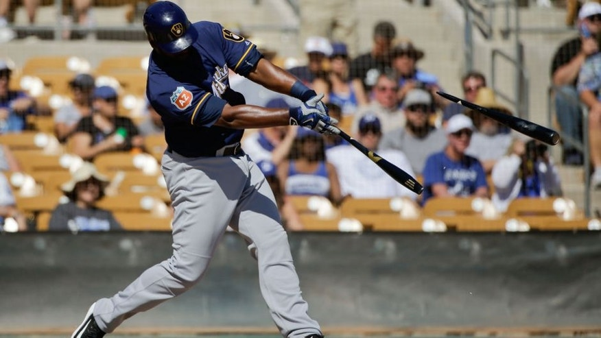 Milwaukee Brewers' Chris Carter breaks his bat during the fourth inning of a spring training baseball game against the Los Angeles Dodgers Monday, March 14, 2016, in Phoenix.