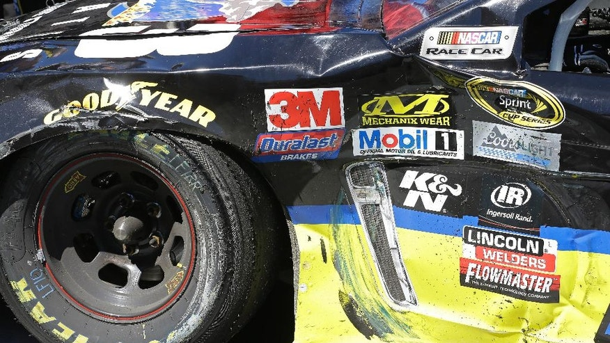 The damaged front left quarter panel of Tony Stewart's race car is viewed after he won the NASCAR Sprint Cup Series auto race Sunday, June 26, 2016, in Sonoma, Calif. (AP Photo/Ben Margot)