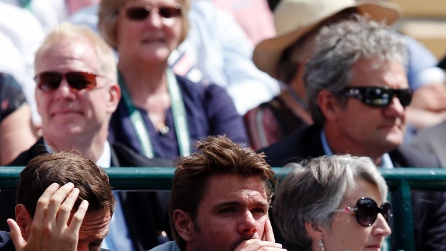 Stan Wawrinka of Switzerland, centre, watches as Donna Vekic of Croatia plays Venus Williams of the US during their Women's Singles Match on day one of the Wimbledon Tennis Championships in London, Monday, June 27, 2016. (AP Photo/Ben Curtis)