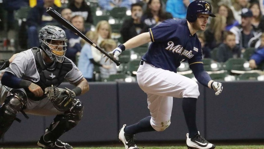 Milwaukee Brewers' Alex Presley hits an RBI infield single during the eighth inning of a baseball game against the San Diego Padres Saturday, May 14, 2016, in Milwaukee. (AP Photo/Morry Gash)