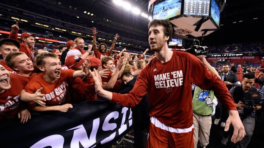 <p>Apr 4, 2015; Indianapolis, IN, USA; Wisconsin Badgers forward Frank Kaminsky (44) celebrates with fans after defeating the Kentucky Wildcats in the 2015 NCAA Men's Division I Championship semi-final game at Lucas Oil Stadium. Mandatory Credit: Bob Donnan-USA TODAY Sports</p>